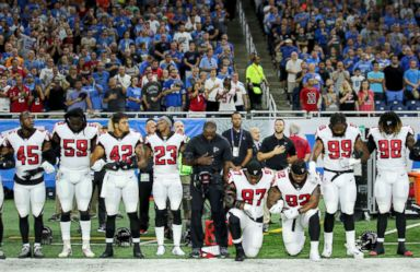 PHOTO: Members of the Atlanta Falcons football team, Grady Jarrett and Dontari Poe, take a knee during the playing of the national anthem prior to the start of the game against the Detroit Lions at Ford Field on Sept. 24, 2017 in Detroit.