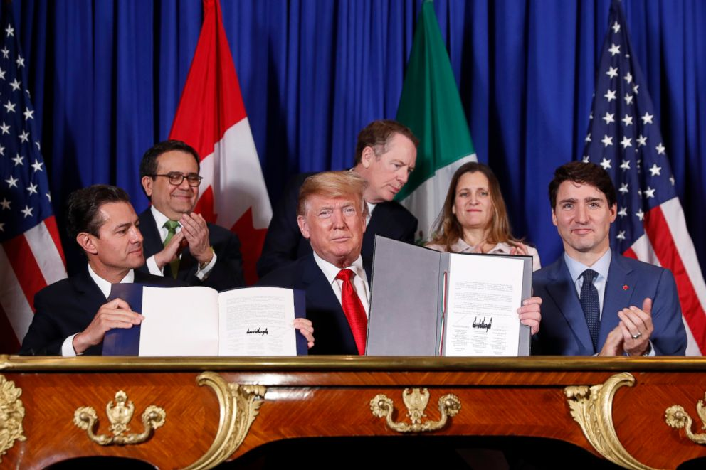 PHOTO: President Donald Trump, center, Canadas Prime Minister Justin Trudeau and Mexicos President Enrique Pena Nieto, left, participate in the USMCA signing ceremony, Nov. 30, 2018, in Buenos Aires.