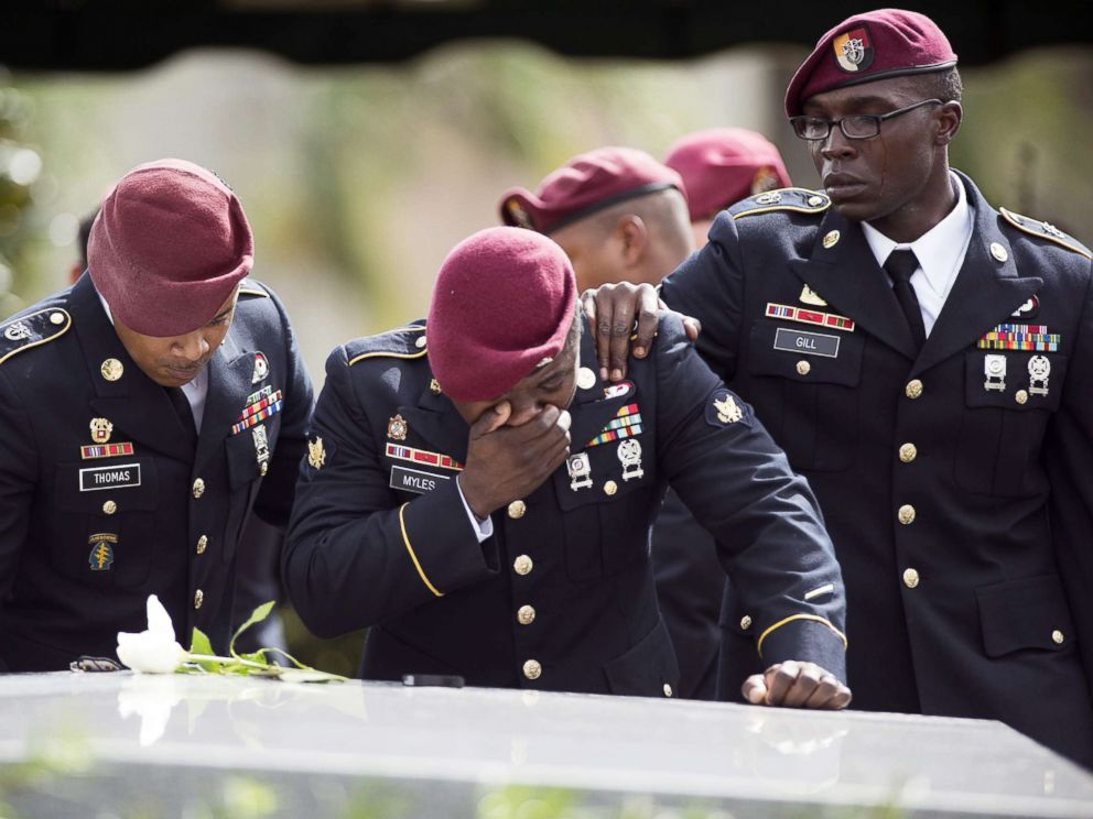 PHOTO: Members of the 3rd Special Forces Group, 2nd battalion, cry at the tomb of U.S. Army Sgt. La David Johnson at his burial service in the Memorial Gardens East cemetery on Oct. 21, 2017 in Hollywood, Fla.