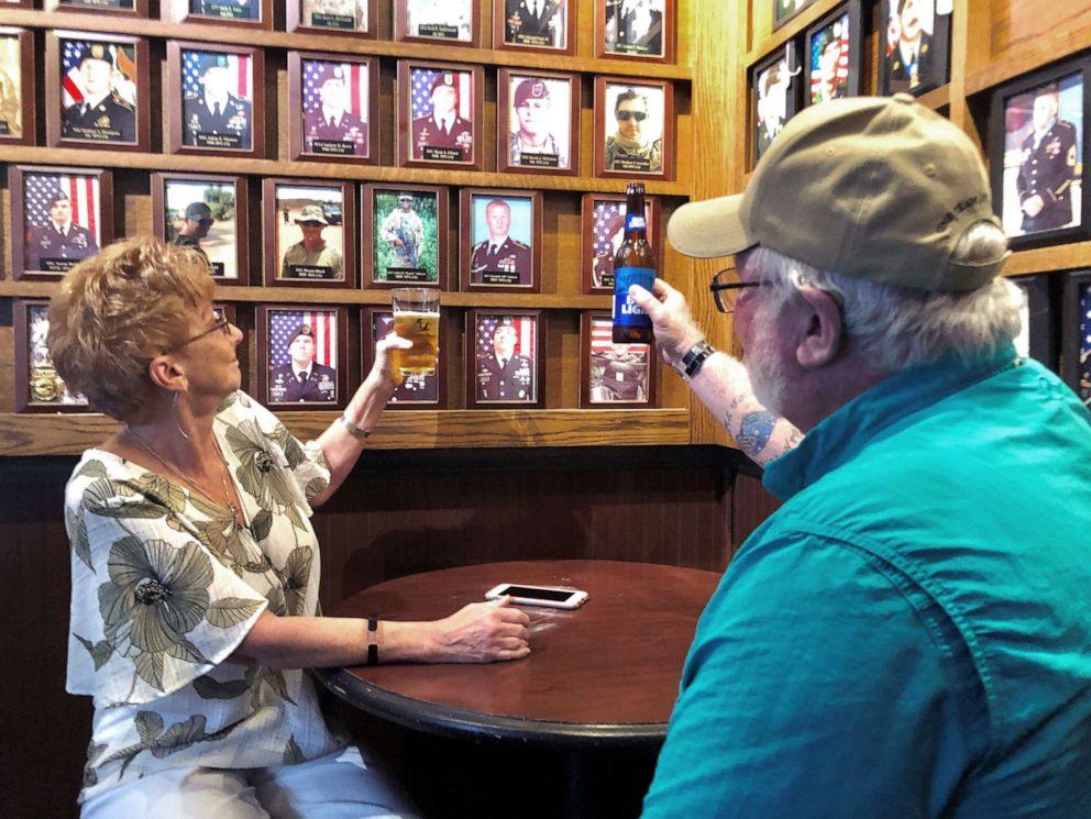 PHOTO: Debra and Ray Gannon toast her son Sgt. 1st Class Jeremiah Johnson at Charlie Mikes bar near Fort Bragg in North Carolina.