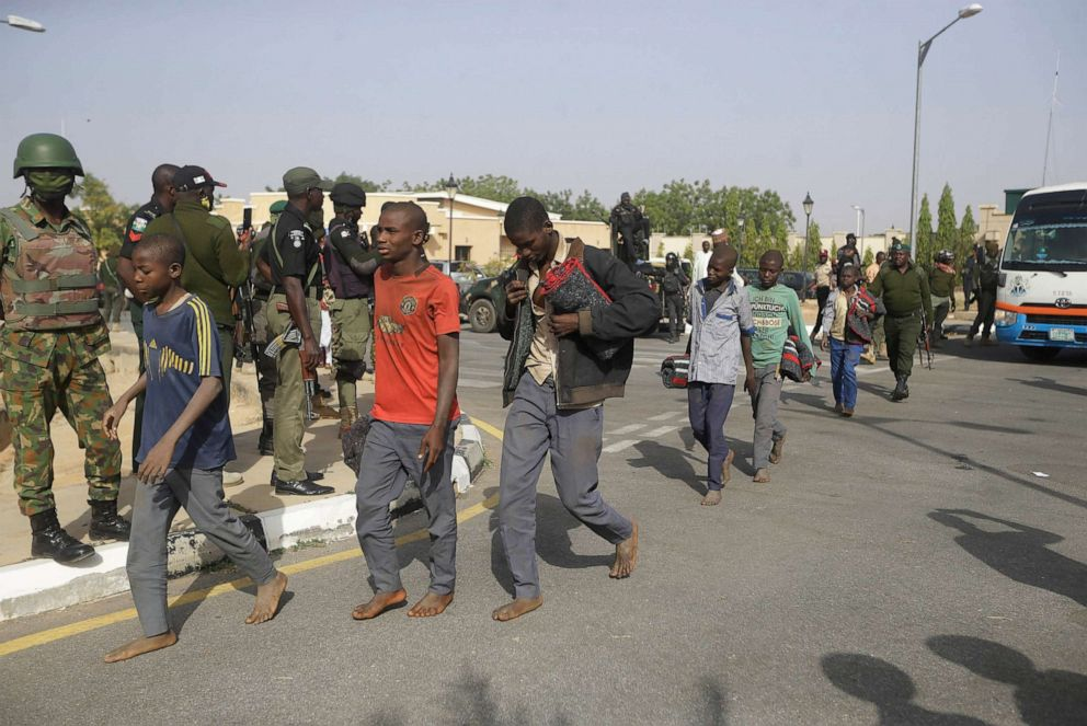 PHOTO: A group of schoolboys are escorted by Nigerian military and officials, Dec. 18, 2020, following their release after they were kidnapped last week in Katsina, Nigeria.