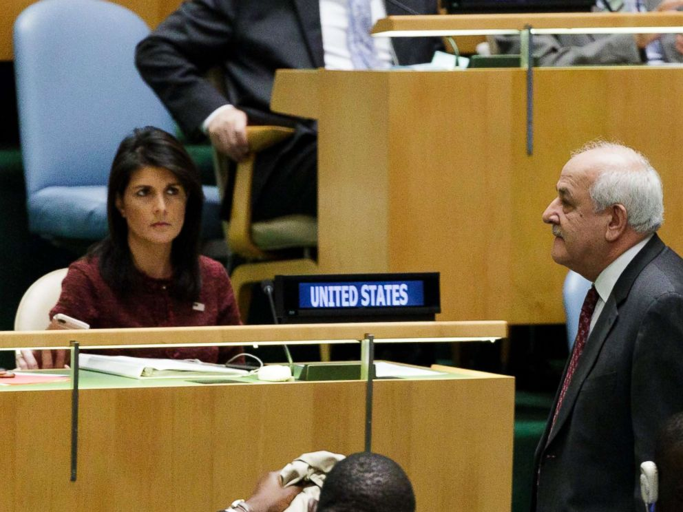 PHOTO: Riyad Mansour (R), Palestines Permanent Observer to the United Nations, walks past U.S. Ambassador to the United Nations Nikki Haley (L), at the U.N. General Assembly, Dec. 21, 2017, at United Nations headquarters in New York.