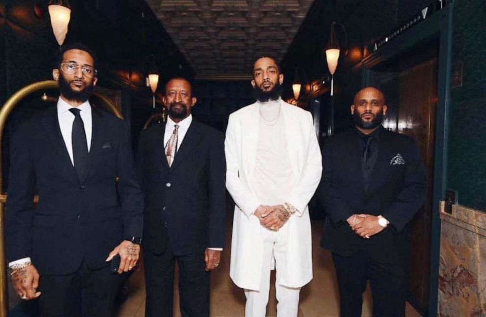 Nipsey Hussle with his brother Samiel Asghedom, left, father Dawit Asghedom, center, and brother Adam Andebrhan.