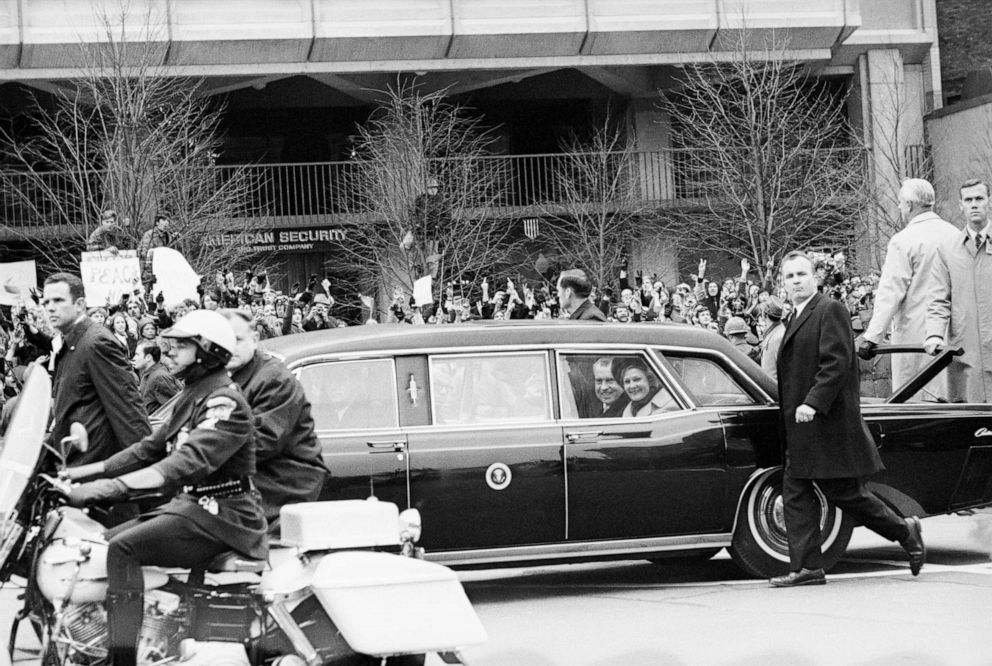 PHOTO: President Richard Nixon and First Lady Pat Nixon in the presidential limousine, surrounded by secret service after taking the oath of office as the 37th President of the United States, Jan. 20, 1969.