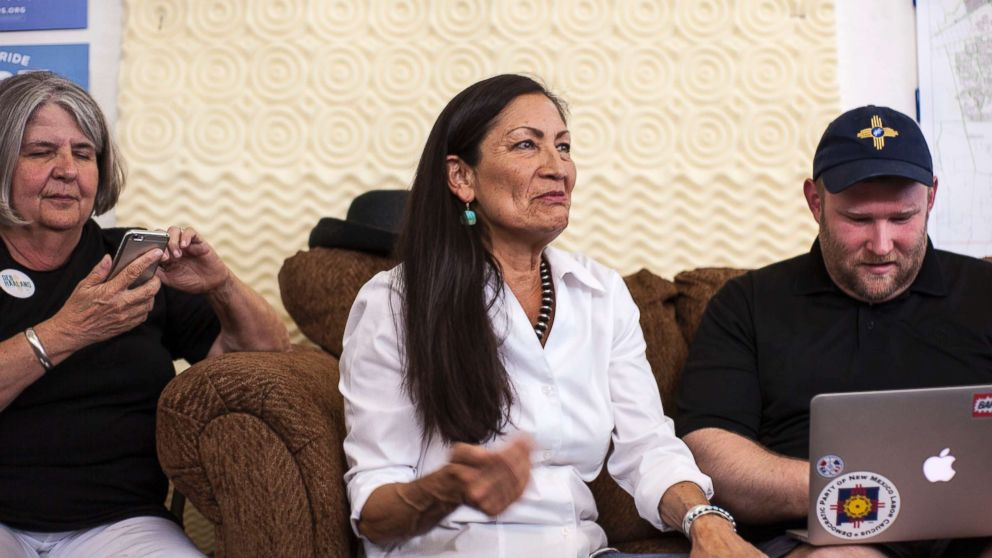 Deb Haaland, center, speaks with campaign organizers at the Haaland headquarters in Albuquerque, New Mexico, June 5, 2018. Haaland, a tribal member of Laguna Pueblo, is aiming to become the first Native American woman in Congress.