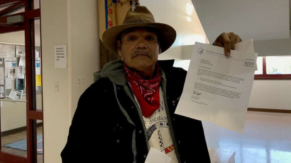 Bill Left Hand, 56, holds up a letter from the U.S. Department of Health and Human Services at the Standing Rock Indian Reservation tribal headquarters in Fort Yates, N.D.