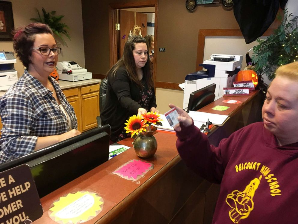 PHOTO: Delaine Belgarde, right, shows the new Turtle Mountain Band of Chippewa ID she received, Oct. 24, 2018, in Belcourt, N.D.