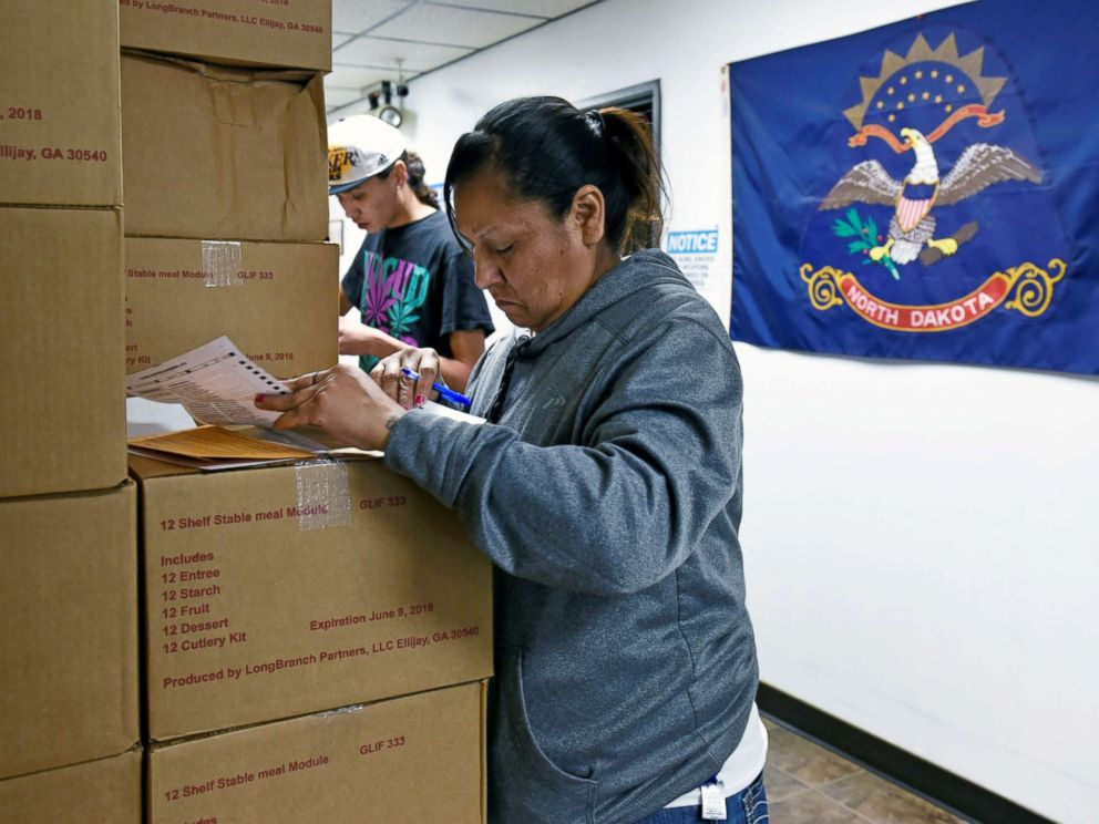 PHOTO: Sherri Two Horses fills out an absentee ballot for the 2018 mid-term election at the Sioux County Court House on the Standing Rock Reservation in Fort Yates, North Dakota, Oct. 26, 2018.