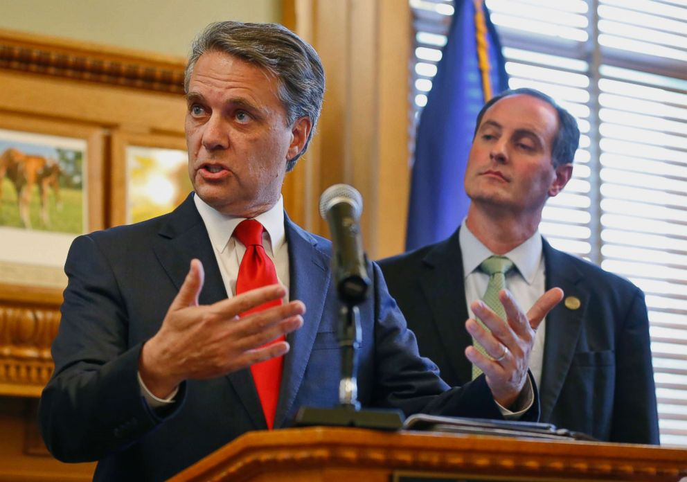 PHOTO: Kansas Gov. Jeff Colyer, left, along with his running mate Tracey Mann, talk to reporters in Topeka, Kan., Aug. 8, 2018, a day after his primary race against Kansas Secretary of State Kris Kobach.