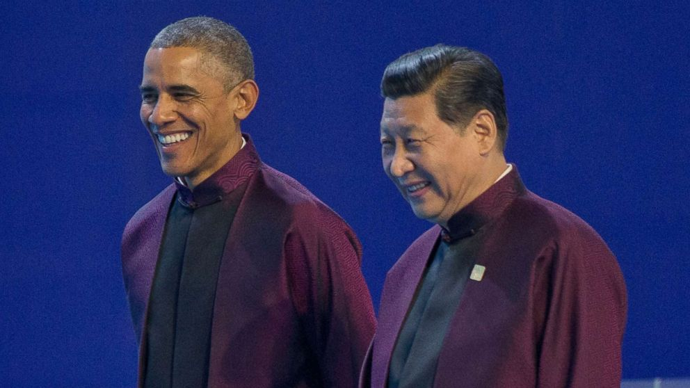 President Barack Obama, left, and Chinese President Xi Jinping walk during the Asia-Pacific Economic Cooperation (APEC) Summit family photo, Nov. 10, 2014 in Beijing.