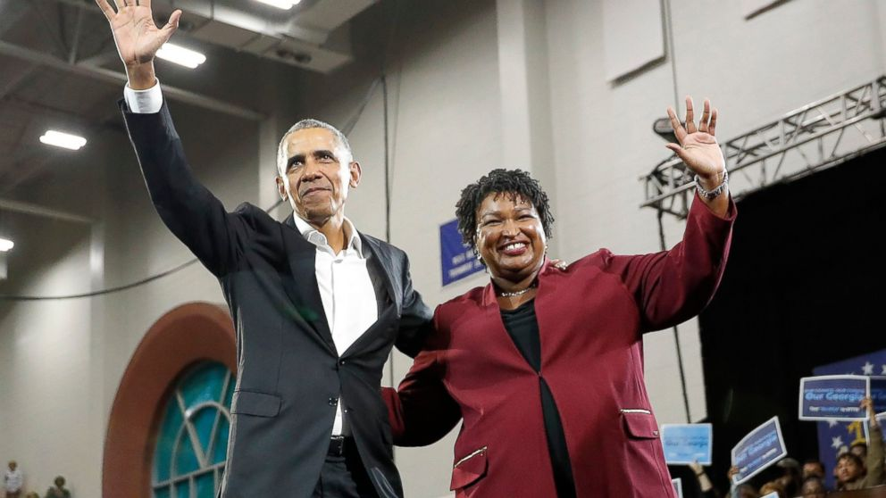 Former President Barack Obama and Democratic candidate for Georgia governor, Stacey Abrams, wave to the crowd during a campaign rally at Morehouse College Friday, Nov. 2, 2018, in Atlanta.