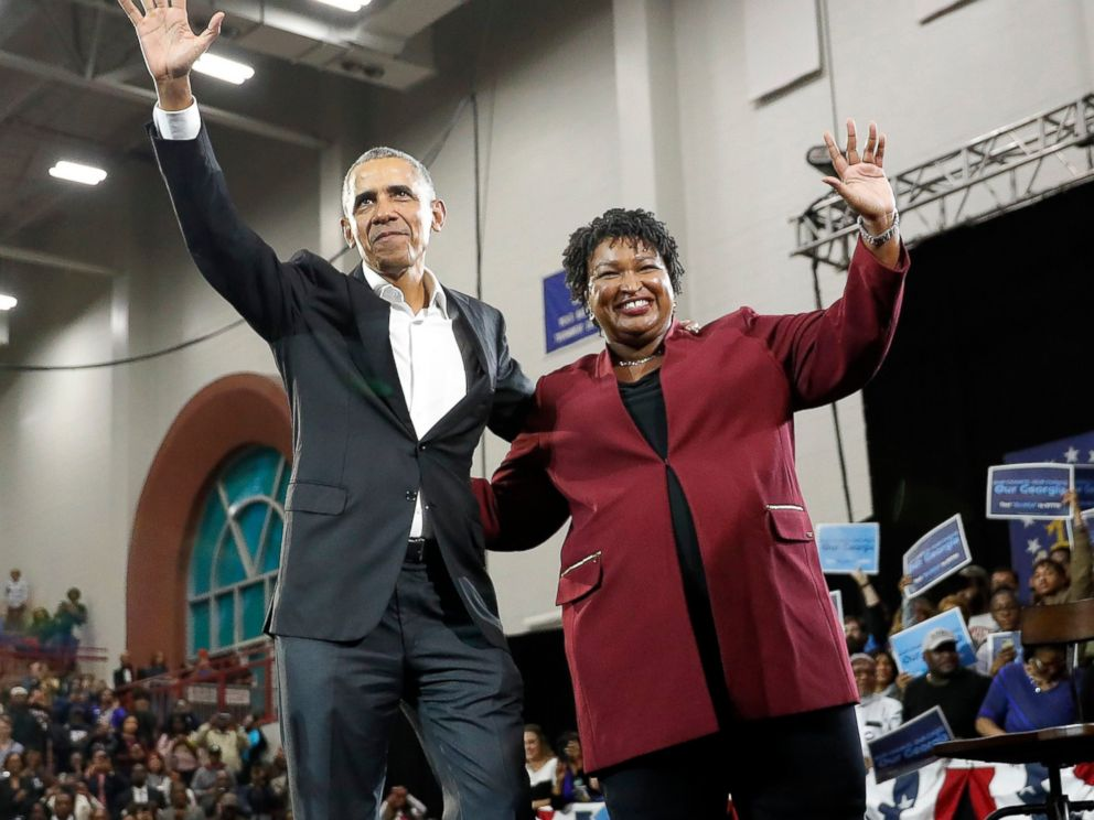 PHOTO: Former President Barack Obama and Democratic candidate for Georgia governor, Stacey Abrams, wave to the crowd during a campaign rally at Morehouse College Friday, Nov. 2, 2018, in Atlanta.