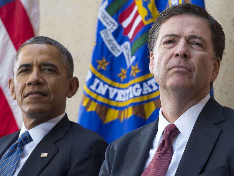 PHOTO: Barack Obama sits alongside James Comey during an installation ceremony at Federal Bureau of Investigation Headquarters in Washington, DC, Oct. 28, 2013.
