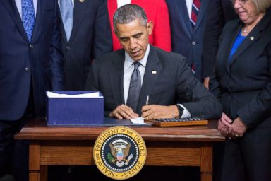 PHOTO: President Barack Obama signs the Every Student Succeeds Act, Dec. 10, 2015, in Washington, DC.