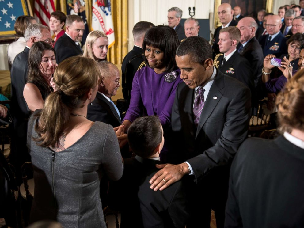 PHOTO: President Barack Obama and first lady Michelle Obama greet family members of fallen soldiers after a Medal of Honor ceremony in the East Room of the White House, Feb. 11, 2013.