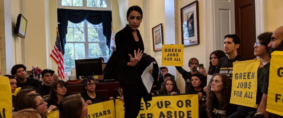PHOTO: Representative-elect Alexandria Ocasio-Cortez talks to protesters in a photo taken by members of the activist group Sunrise Movement.