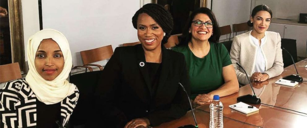 PHOTO: Ilhan Omar, Ayanna Pressley, Rashida Tlaib, and Alexandria Ocasio-Cortez sit at a table together at new House member orientation, Nov. 13, 2018.
