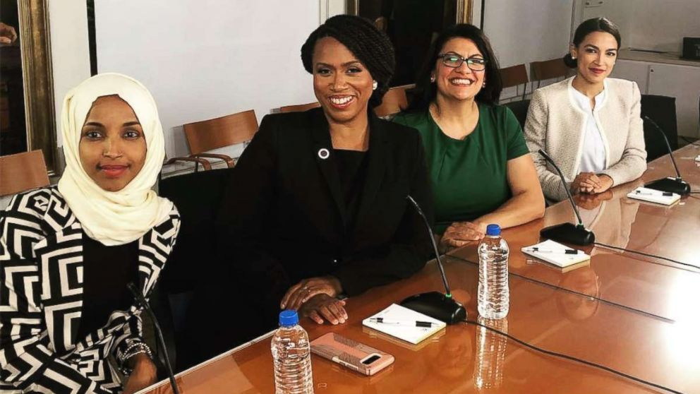 Ilhan Omar, Ayanna Pressley, Rashida Tlaib, and Alexandria Ocasio-Cortez sit at a table together at new House member orientation, Nov. 13, 2018.