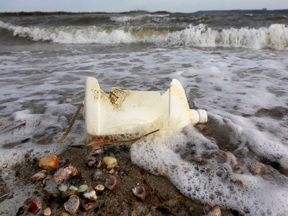 PHOTO: A plastic container litters the beach in Sandy Hook, N.J., April 18, 2011.