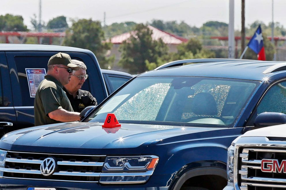 PHOTO: Officials at the scene in Odessa, Texas on Sept. 2, 2019, where teenager Leilah Hernandez was fatally shot at a car dealership during a shooting rampage that killed seven.