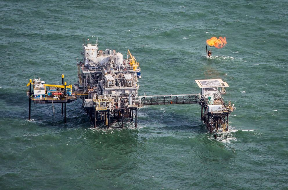 PHOTO: Aerial view of an oil production platform in the Gulf of Mexico with a flare of fthe coast of Port Fourchon, Louisianas southernmost port.