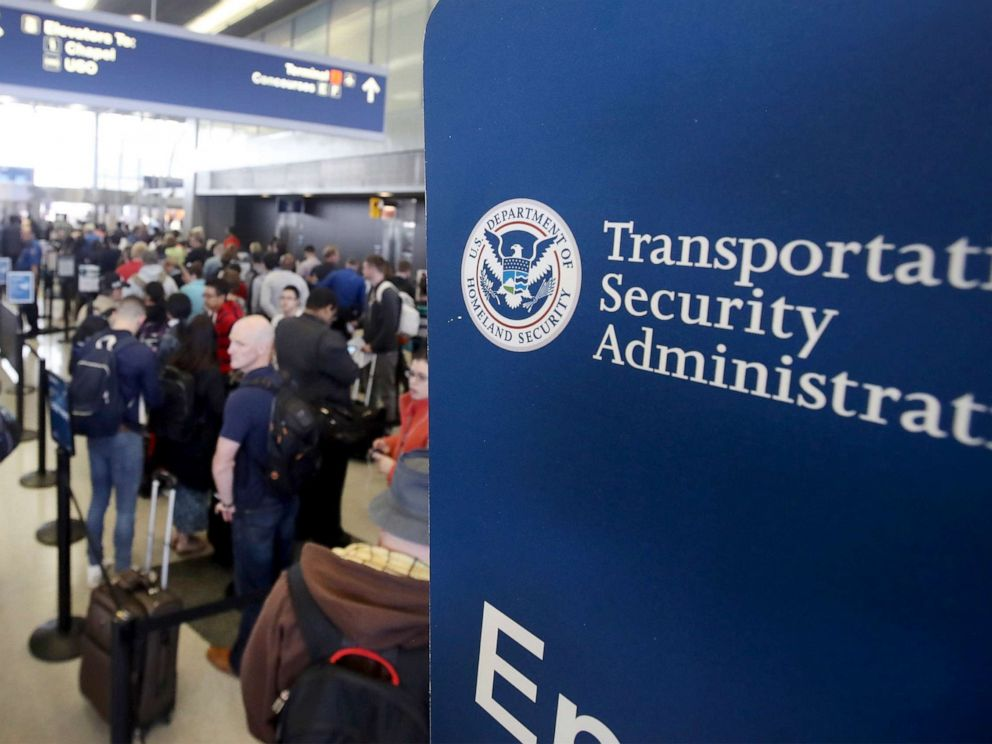 PHOTO: Passengers at OHare International Airport wait in line to be screened at a Transportation Security Administration (TSA) checkpoint.