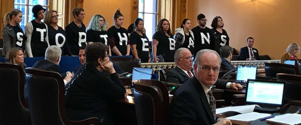 PHOTO: Abortion-rights activists stand in protest on Wednesday, Dec. 13, 2017, in the Ohio Senate chamber in Columbus, after passage of a bill banning abortions in cases of a Down syndrome diagnosis.