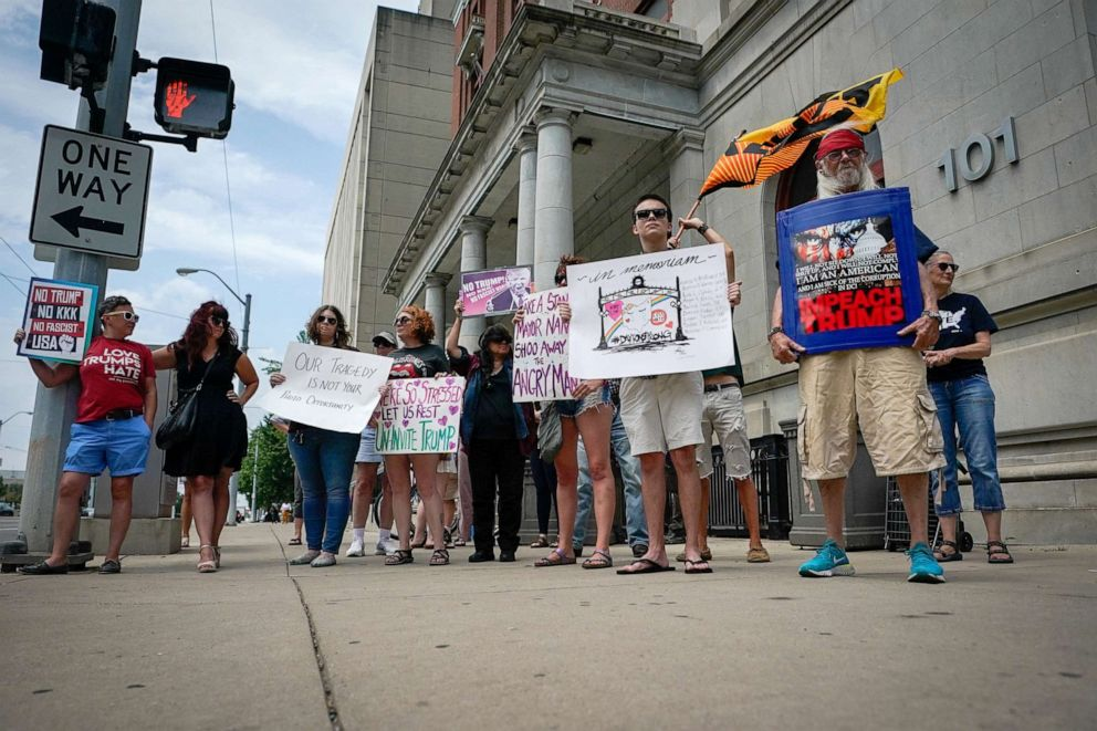 PHOTO: A small group of protesters gather at city hall in opposition to U.S. President Donald Trump visit to Dayton following a mass shooting in Dayton, Ohio, Aug. 6, 2019.