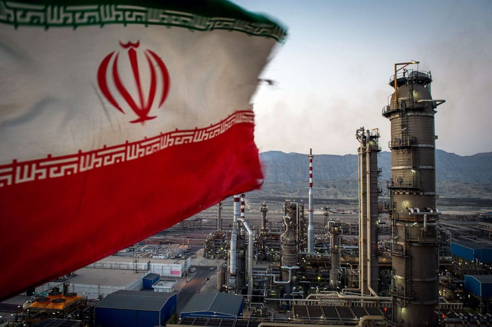 PHOTO: An Iranian national flag flies at the Persian Gulf Star Co. gas condensate refinery in Bandar Abbas, Iran in this Jan. 9. 2019 file photo.