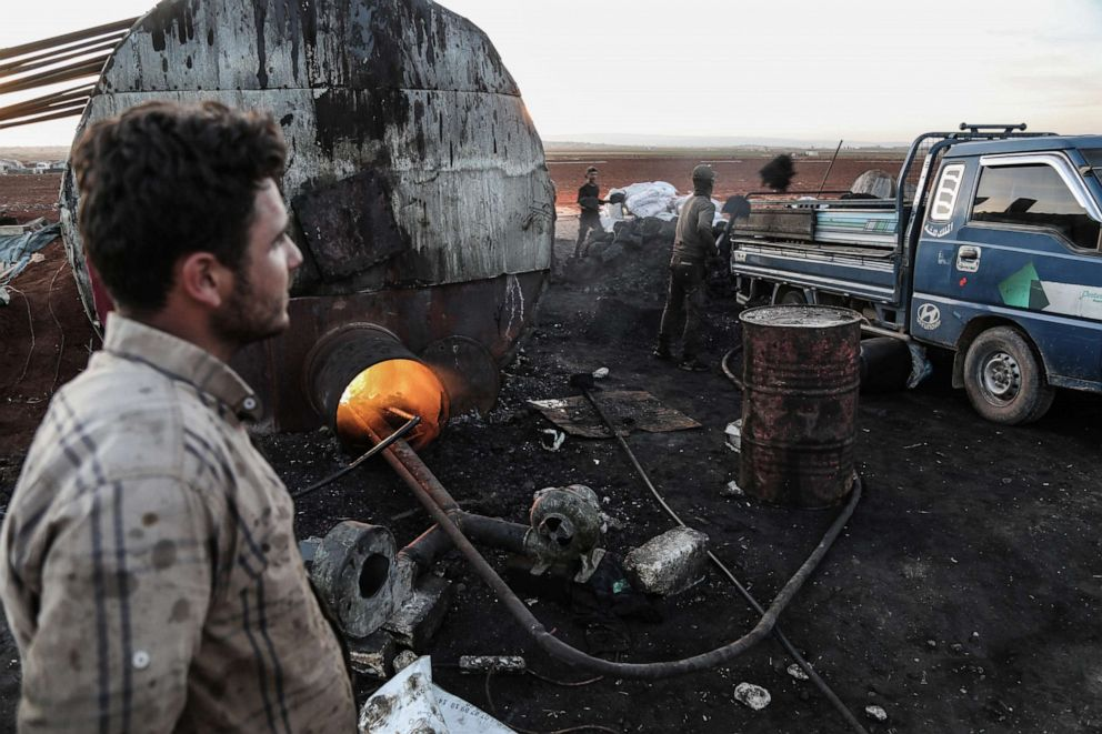 PHOTO: Syrians work at a primitive oil facility, where petrol for cars and heating fuel are being extracted from crude oil purchased from wells controlled by the predominantly Kurdish Syrian Democratic Forces in Maarat al-Naasan, Syria, Oct. 31, 2018.