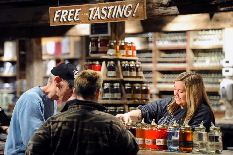 PHOTO: An employee pours moonshine samples for customers at Ole Smoky Distillery in Gatlinburg, Tenn., April 16, 2015.
