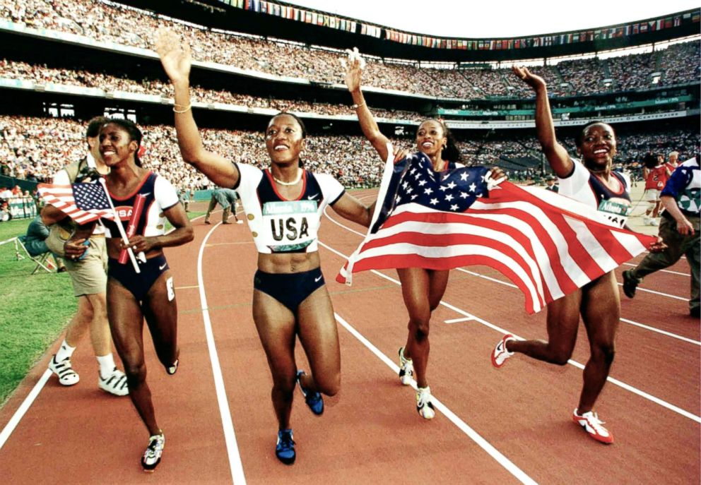 The USA 4x100 relay team, Gwen Torrance, Inger Miller, Gail Devers and Christy Gains celebrate after winning the gold medal during the 1996 Centennial Olympic games at Olympic Stadium in Atlanta, Aug. 03, 1996.