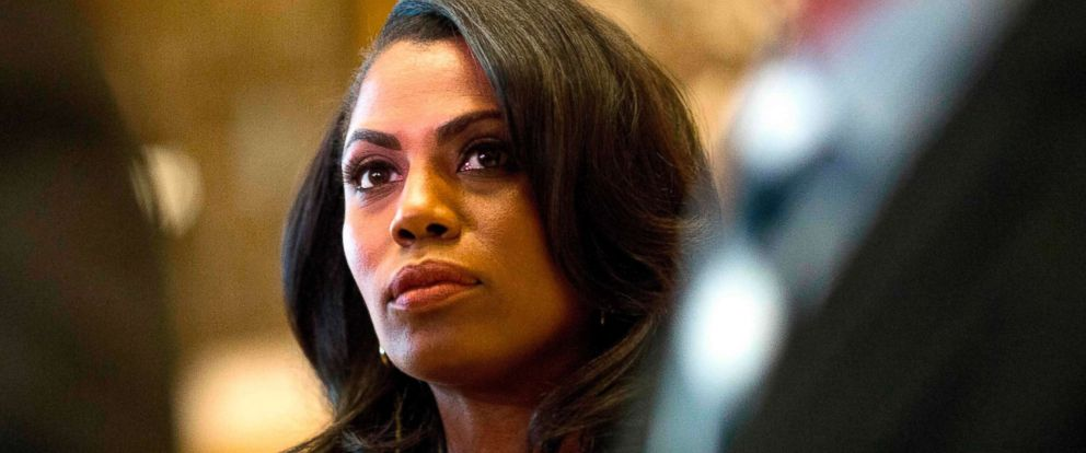 PHOTO: Omarosa Manigault, a staffer for US President-elect Donald Trump, listens as Martin Luther King III speaks to the media after meeting with the President-elect at Trump Tower in New York City on Jan. 16, 2017.