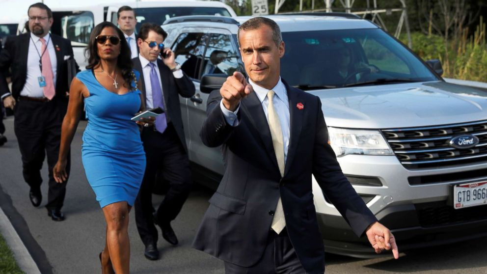 Omarosa Manigault walks to an event for veterans in Struthers, Ohio with Corey Lewandowski, Sebastian Gorka and Anthony Scaramucci, July 25, 2017.