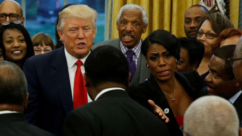 White House aide Omarosa Manigault (center R) and President Donald Trump (center L) with the leaders of dozens of historically black colleges and universities (HBCU) in the Oval Office at the White House in Washington, D.C., Feb. 27, 2017.