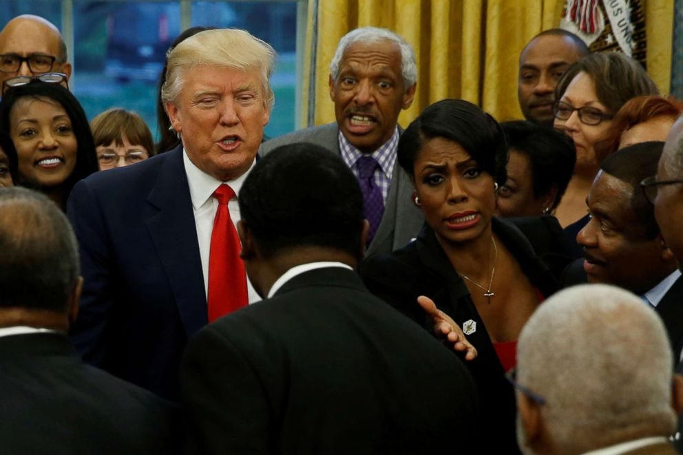 PHOTO: White House aide Omarosa Manigault (center R) and President Donald Trump (center L) with the leaders of dozens of historically black colleges and universities (HBCU) in the Oval Office at the White House, Feb. 27, 2017.
