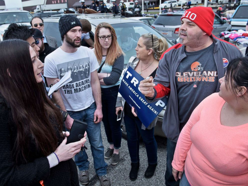 PHOTO: People of opposing political views talk in a parking lot after a Trump rally at the International Exposition Center on March 12, 2016 in Cleveland, Ohio.