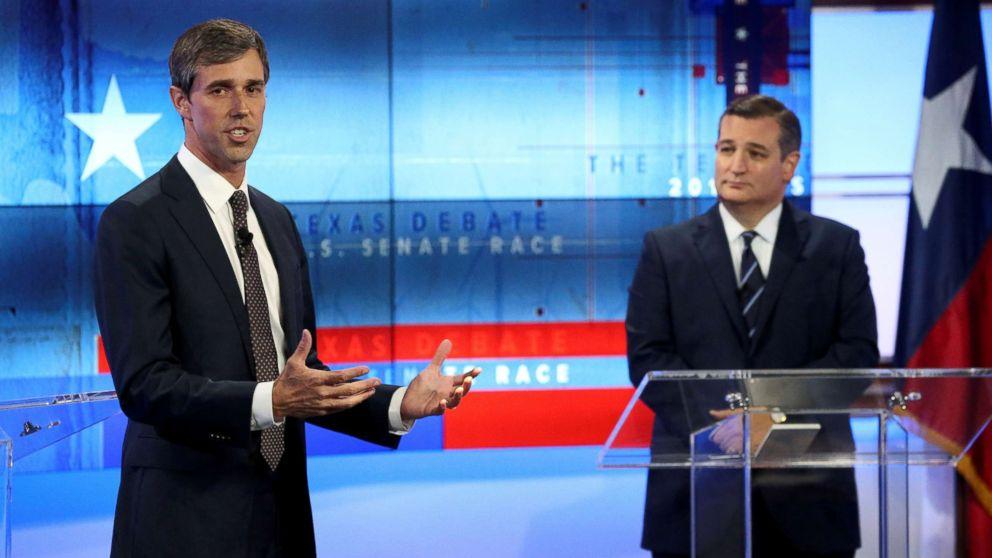 Rep. Beto O'Rourke speaks, as Senator Ted Cruz looks on, during a debate at the KENS-5 Studios in San Antonio, Texas, Oct. 16, 2018.
