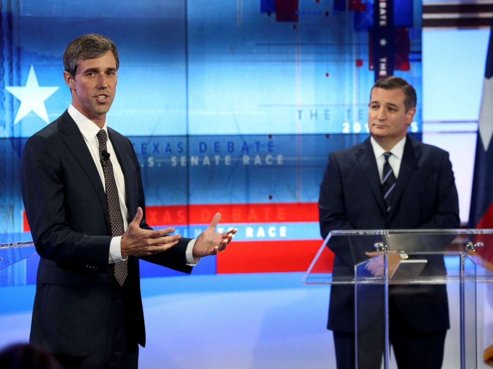 PHOTO: Rep. Beto ORourke speaks, as Senator Ted Cruz looks on, during a debate at the KENS-5 Studios in San Antonio, Texas, Oct. 16, 2018.
