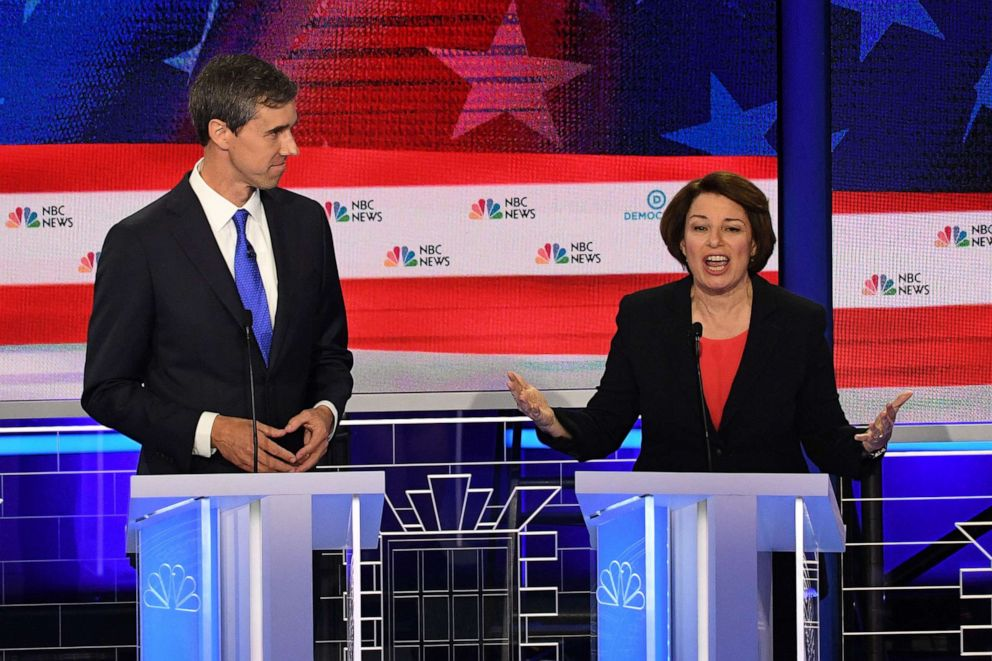 PHOTO: Beto ORourke and Amy Klobuchar participate in the first Democratic primary debate hosted by NBC News at the Adrienne Arsht Center for the Performing Arts in Miami, Florida, June 26, 2019.