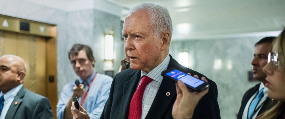 PHOTO: Sen. Orrin Hatch talks with reporters after a Senate Judiciary Committee hearing on judicial nominations, Oct. 24, 2018, in Washington, DC.