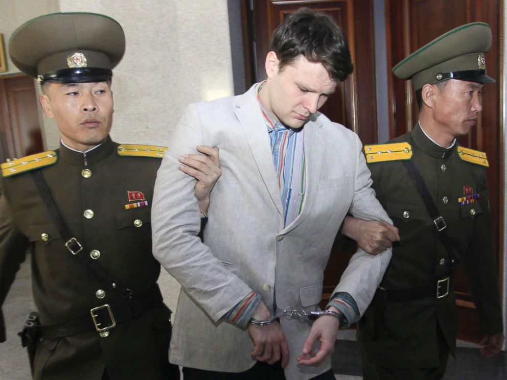 PHOTO: American student Otto Warmbier, center, is escorted at the Supreme Court in Pyongyang, North Korea, on March 16, 2016.