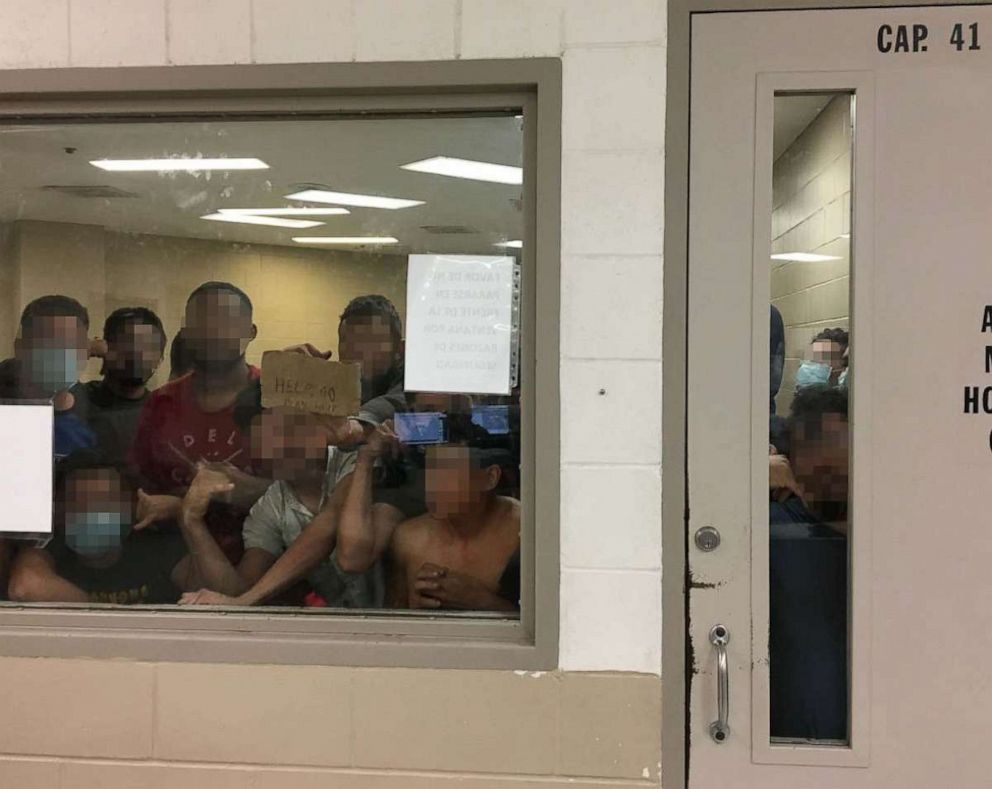 PHOTO: Eighty-eight adult males held in a cell with a maximum capacity of 41, some signaling prolonged detention to OIG Staff, observed by the Office of Inspector General, June 12, 2019, at Border Patrols Fort Brown Station.
