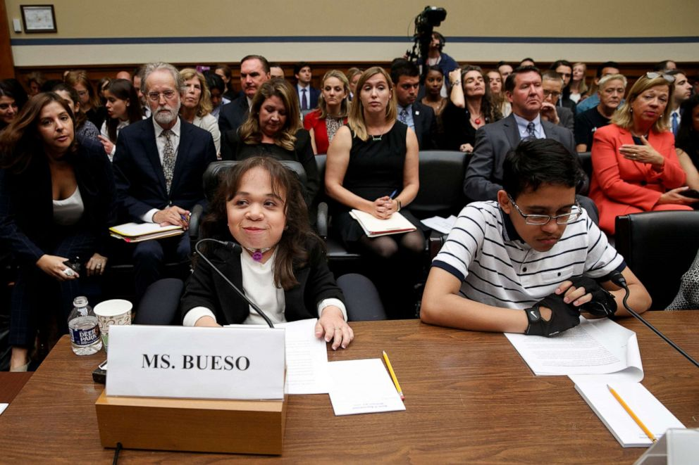 PHOTO: Maria Isabel Bueso, 24, of Concord, Calif., left, and Jonathan Sanchez, 16, of Boston, who both have medical deferred action, take their places at the start of a House Oversight subcommittee hearing, Sept. 11, 2019, on Capitol Hill in Washington.