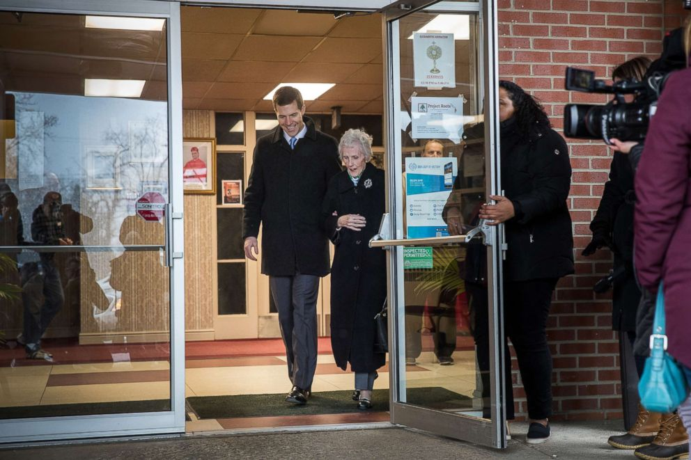 PHOTO: Conor Lamb and his grandmother Barbara Lamb exit the polling station after she voted at Our Lady of Victory Church, March 13, 2018 in Carnegie, Pa.