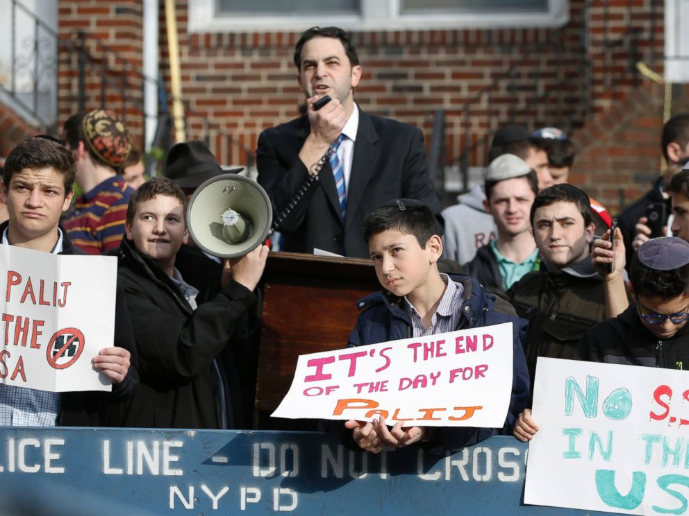 Hillel Goldman associate principal of the Orthodox Jewish Rambam Mesivta High School speaks as he and students from the school protest former Nazi concentration camp guard Jakiw Palij 94 Thursday Nov. 9 2017 in Jackson Heights New York