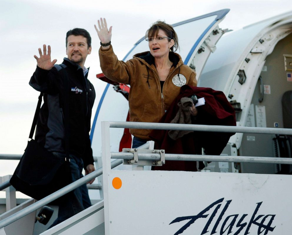 PHOTO: In this Nov. 4, 2008 file photo, Republican vice presidential candidate Alaska Gov. Sarah Palin and her husband Todd wave as they leave Anchorage International Airport in Anchorage bound for Wasilla to vote in the presidential election.