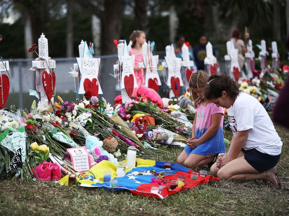 PHOTO: People visit a makeshift memorial setup in front of Marjory Stoneman Douglas High School, Feb. 19, 2018, in Parkland, Florida.