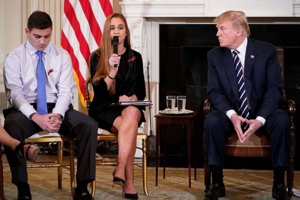 PHOTO: President Donald Trump listens to Julia Cordover, center, the Parkland student body president, as she speaks during a listening session on gun violence in the State Dining Room of the White House.