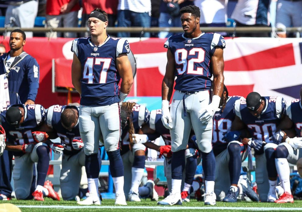 PHOTO: Members of the New England Patriots kneel on the sidelines during the National Anthem before a game against the Houston Texans at Gillette Stadium on Sept.24, 2017n in Foxboro, Mass.